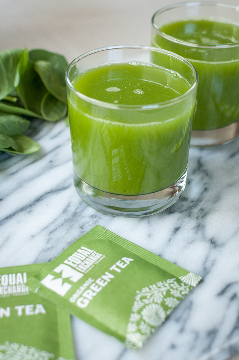 healthy skin green juice in glasses with equal exchange green tea bags