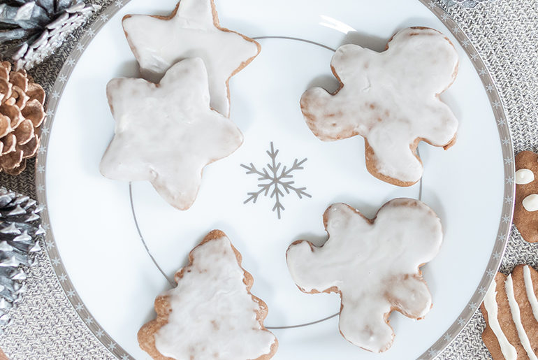 decorated cookies on snowflake plate