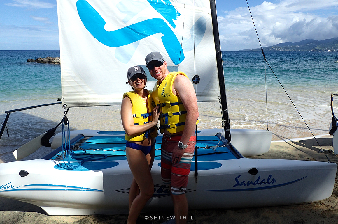 couple in life jackets by catamaran sandals grenada all inclusive resort