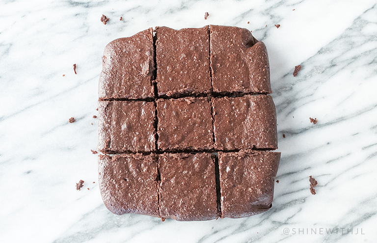 fudge paleo brownies on marble countertop shinewithjl