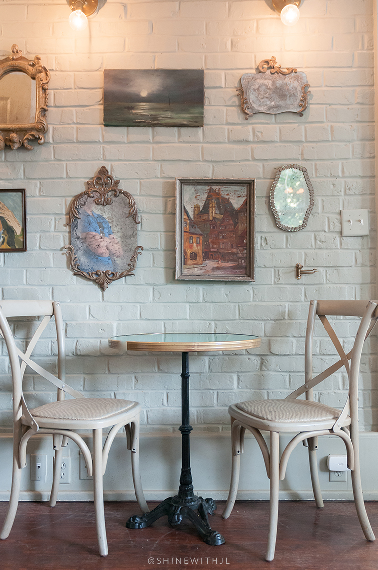 french pedestal table and chairs with framed wall art savannah