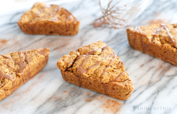 glazed pumpkin scones on marble with whisk shinewithjl