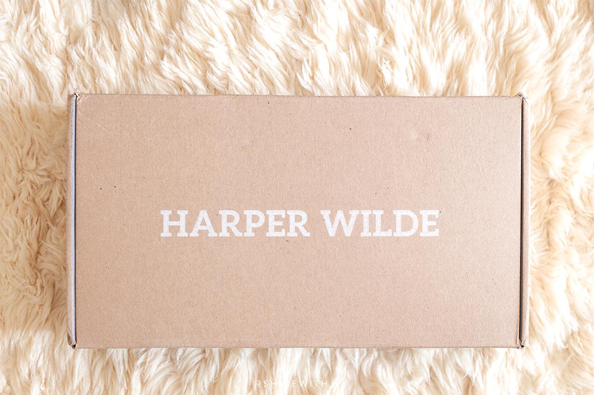 harper wilde shipping box on lambs wool rug
