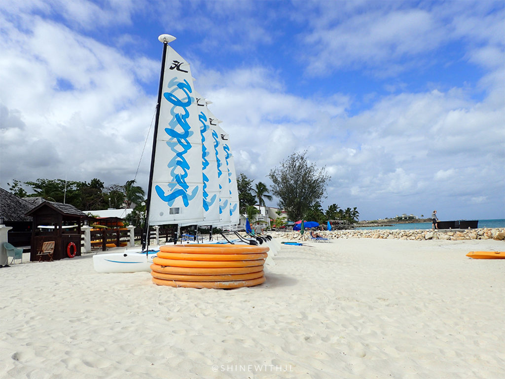 hobie cats and stacked water rafts on beach sandals antigua