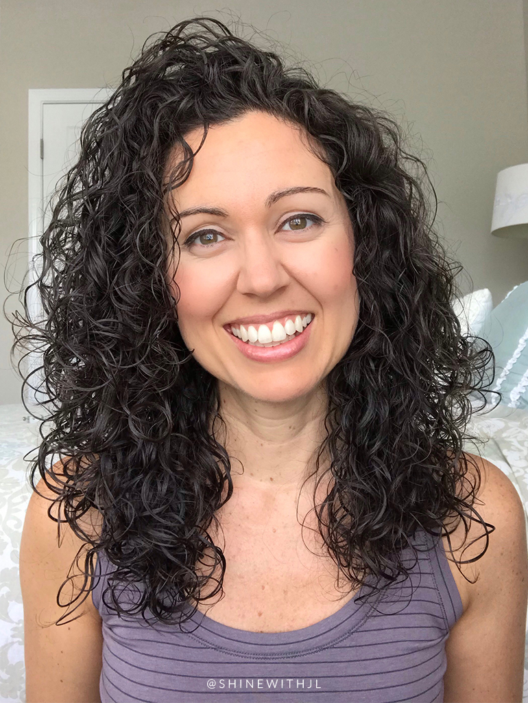 natural makeup look with curly hairstyle and calia top
