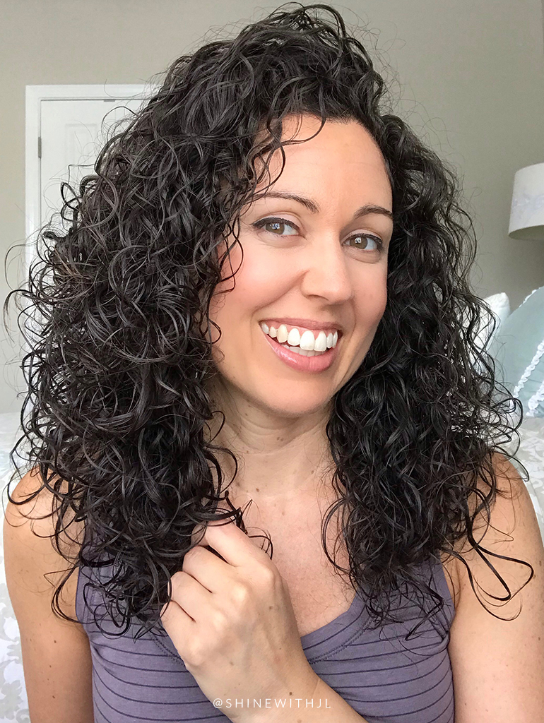 shoulder length curly hairstyle with calia top