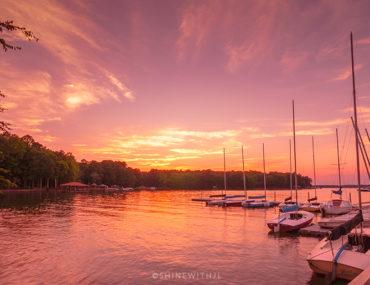 lake norman blythe landing park sunset with sailboats