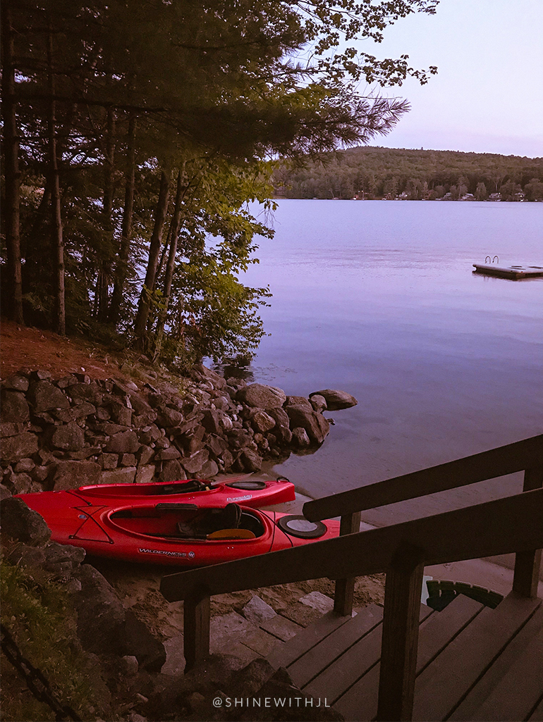 red wilderness systems kayaks on lake waukewan beach at dusk