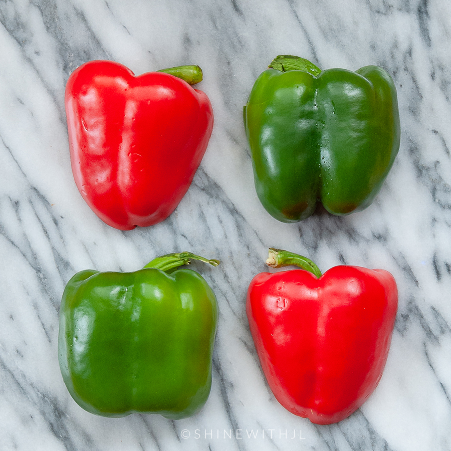 red and green bell peppers halved