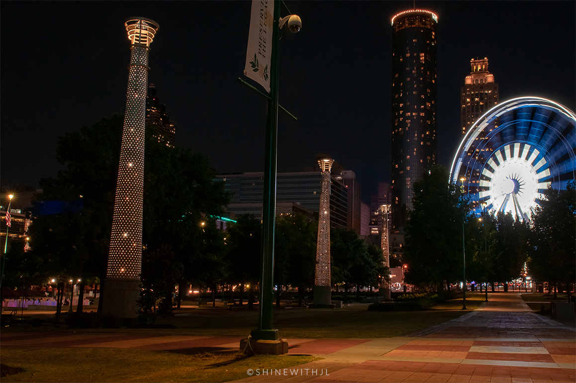 photographer Jennifer Leigh Adams captures movement with light at night at centennial olympic park atlanta