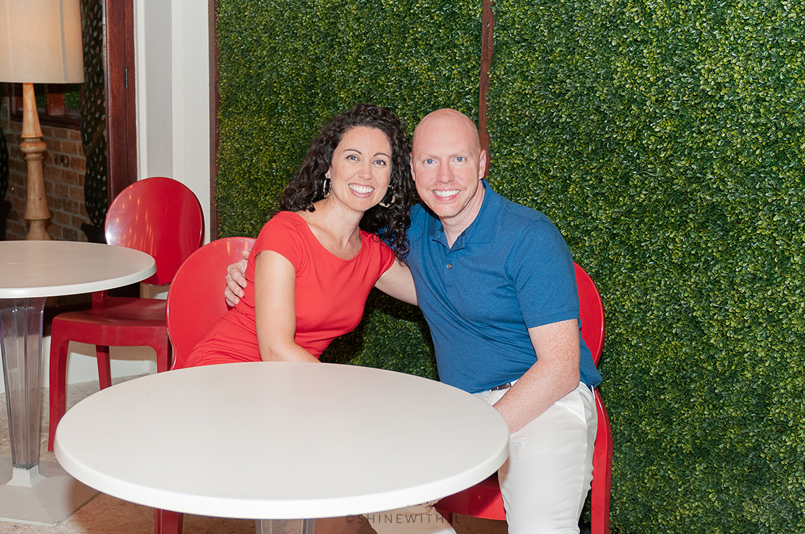 brown curly haired woman at cafe table with husband