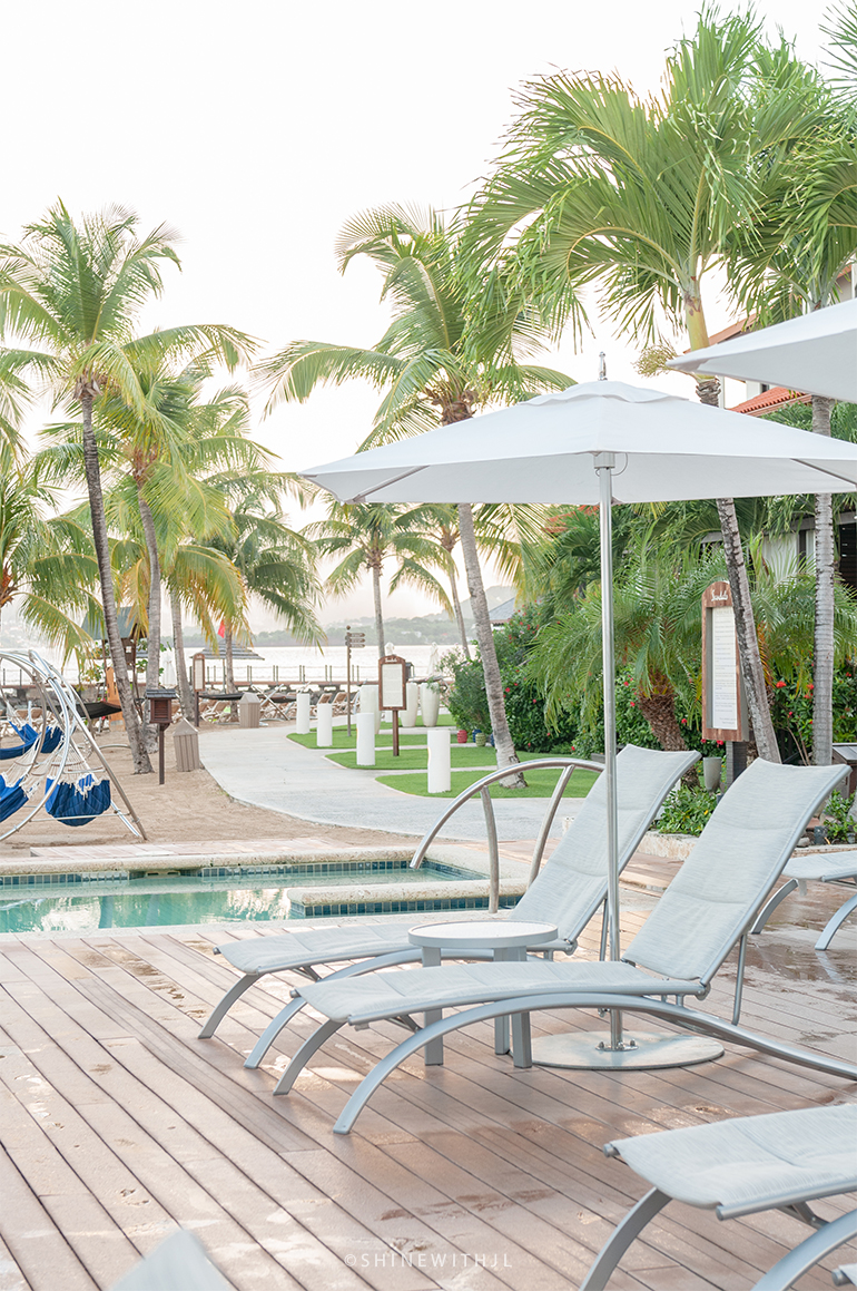padded pool lounge chairs by hot tub at sandals grenada resort