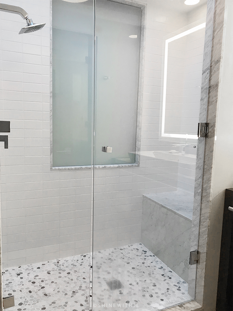 grey and white shower with bench at sandals grenada resort