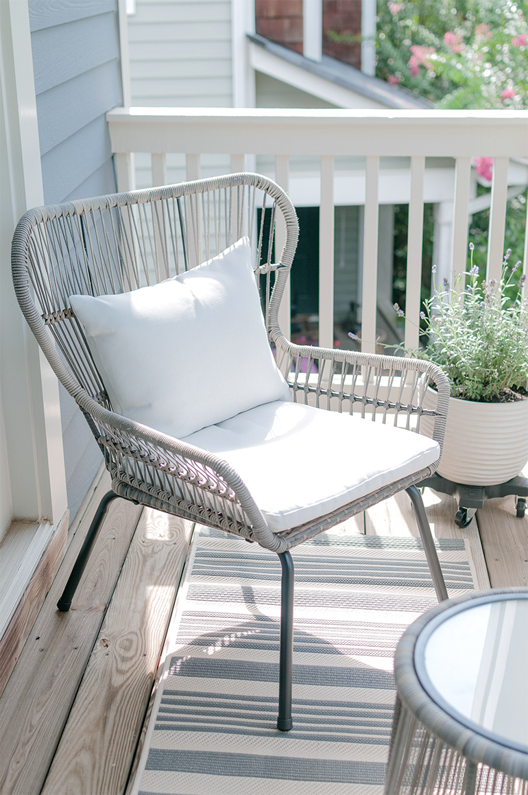 rattan chair with white cushion with lavender plant shine with jennifer leigh