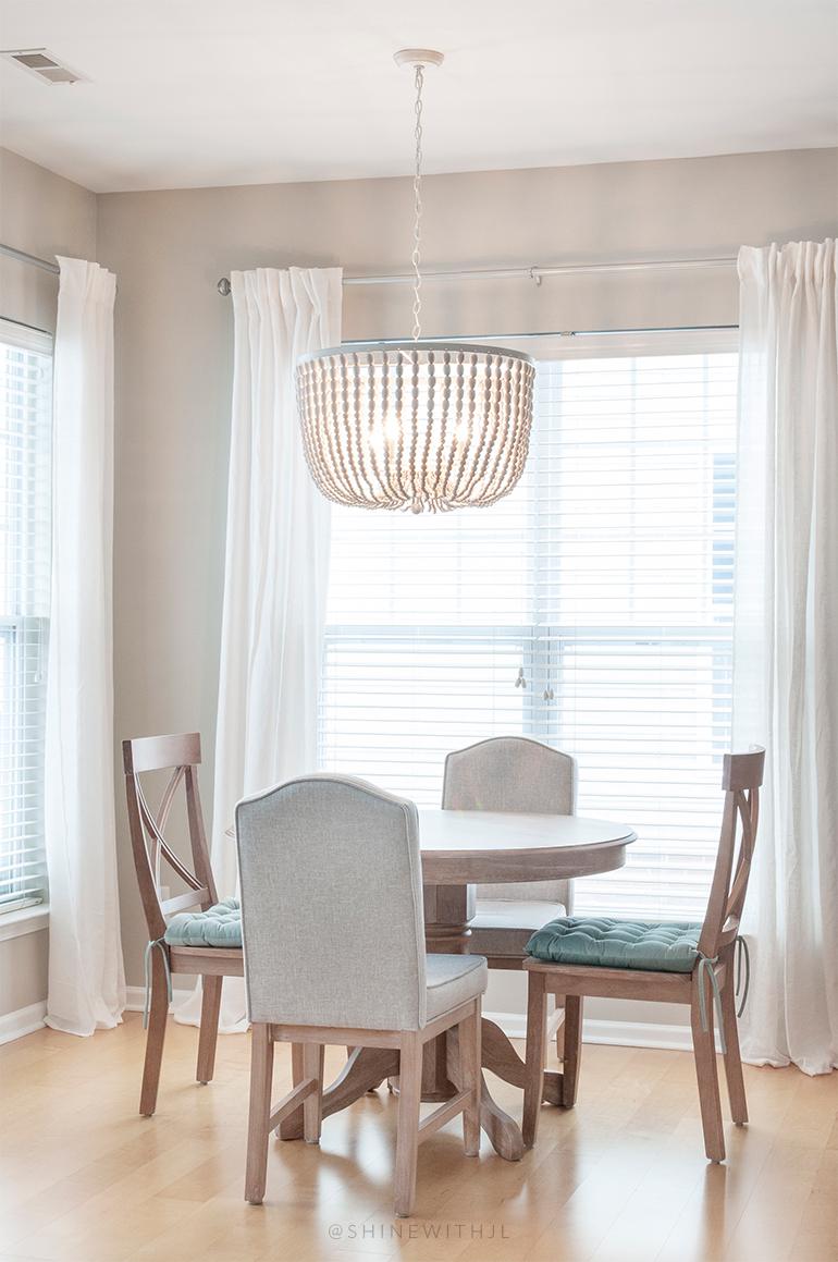 round table breakfast nook beaded chandelier