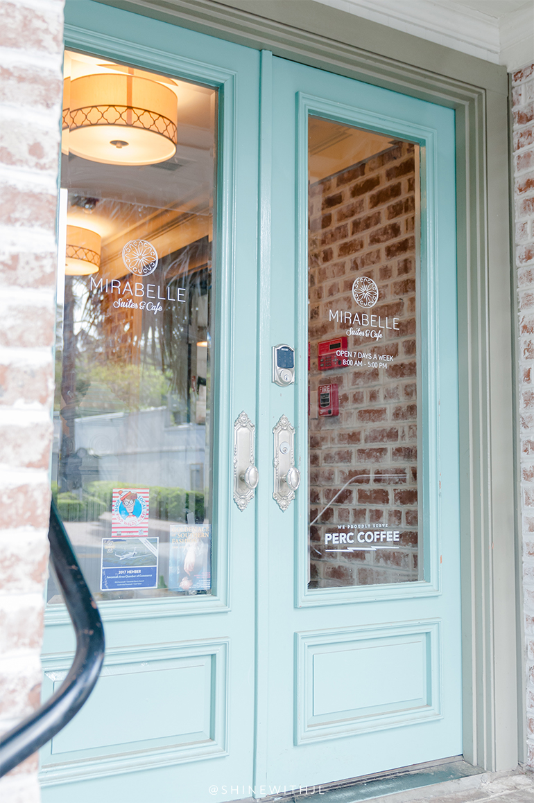 teal double doors with glass european coffee shop