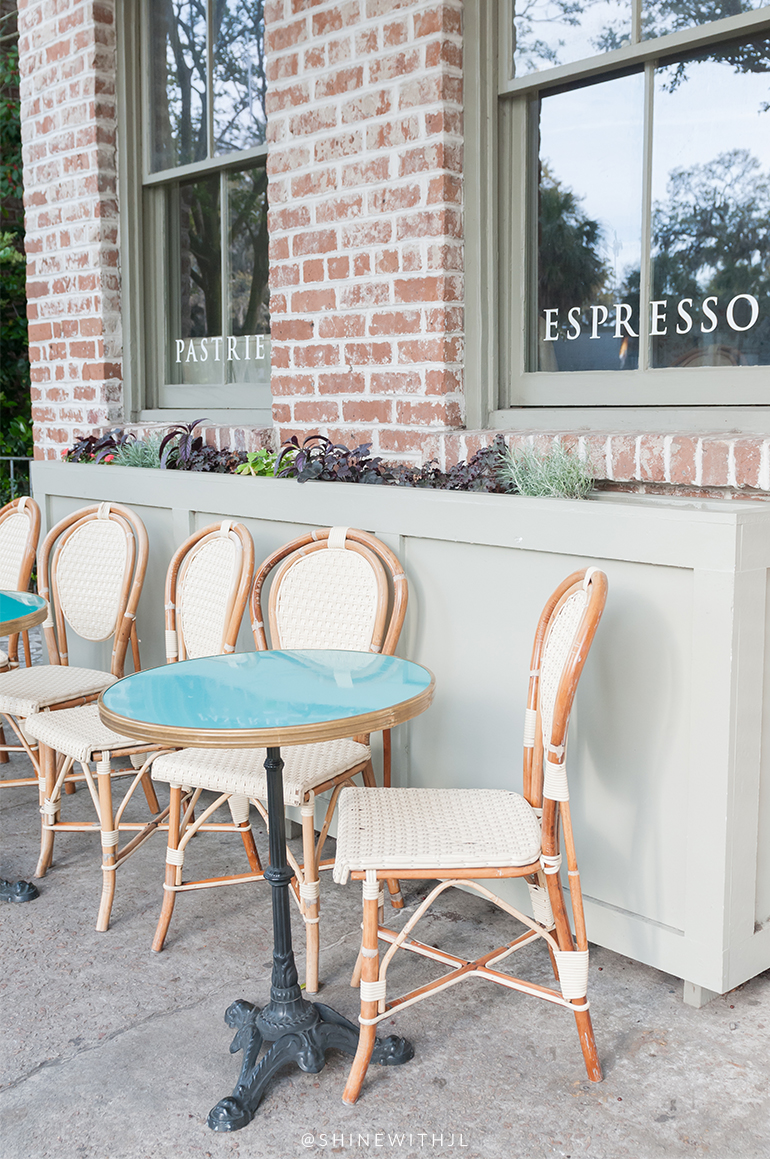 teal and gold pedestal tables at mirabelle cafe savannah