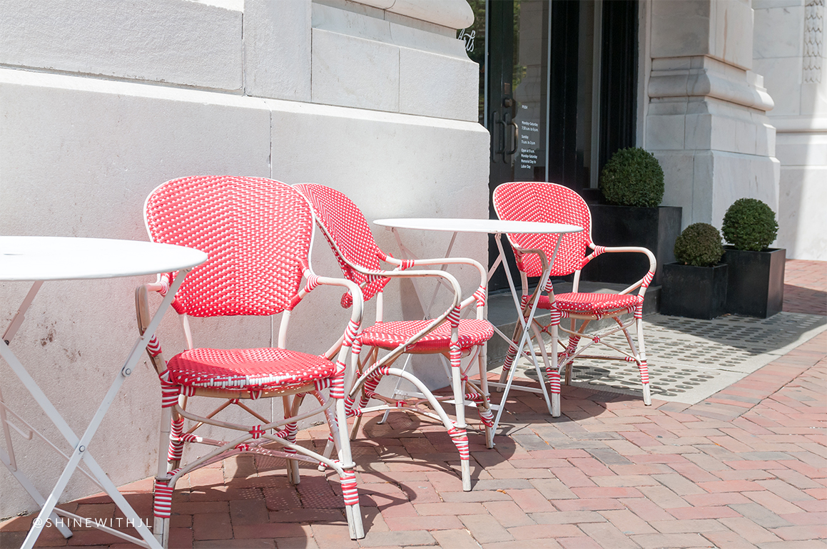 red and white paris dining chairs in front of arts cafe savannah