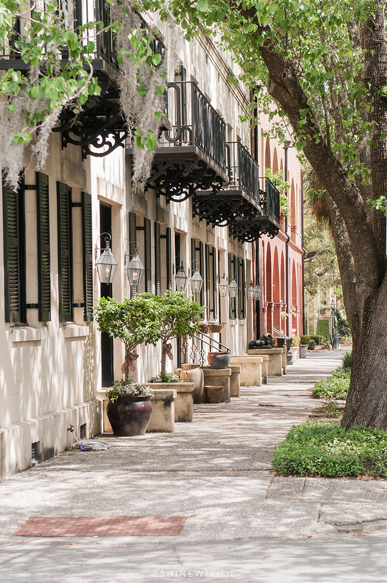 historic savannah homes with matching gas lanterns and balconies