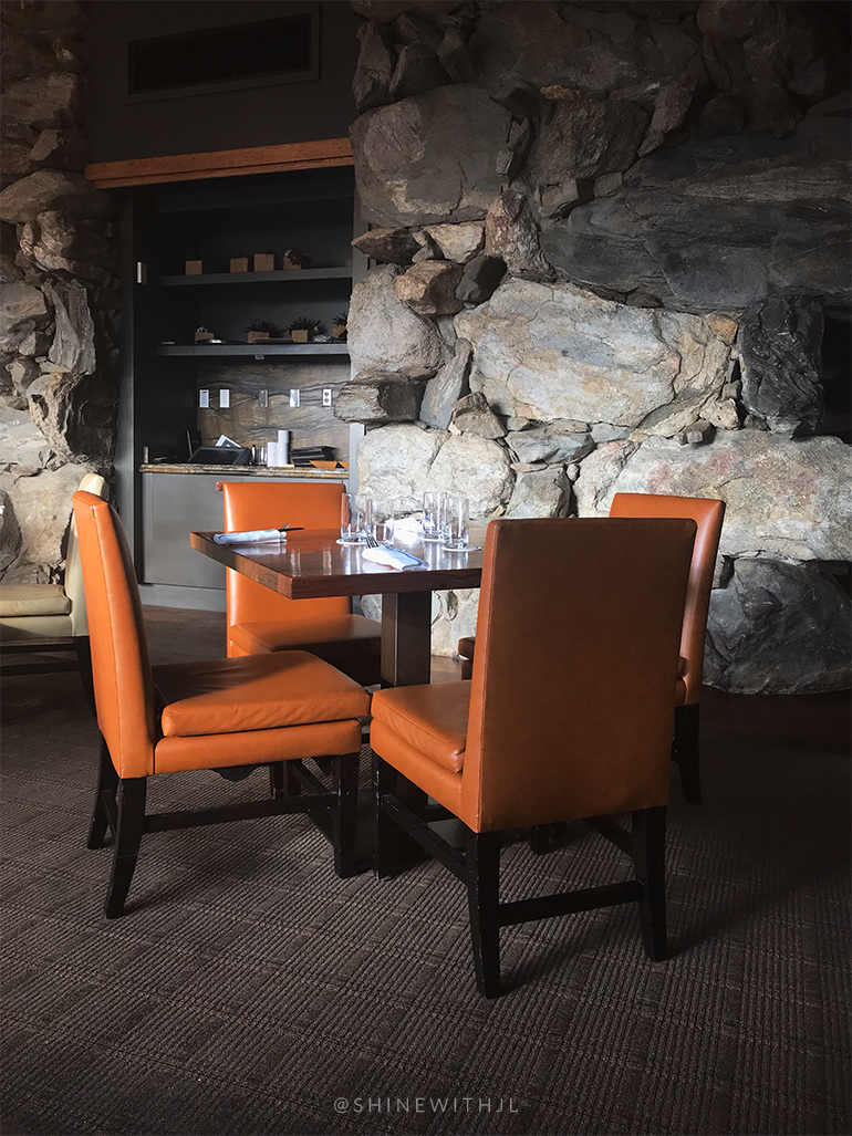 seating with stone wall backdrop edison restaurant omni grove park inn