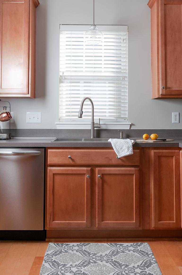 red wood kitchen cabinets stainless steel appliances kitchen sink