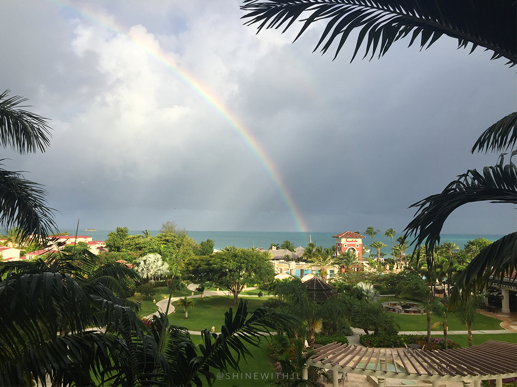rainbow over the ocean sandals grande antigua