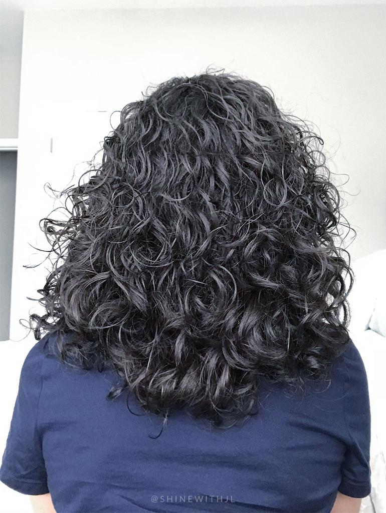 back of curly hair cut medium length