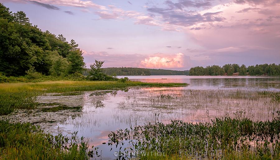 lakes region nh summer sunset on lake waukewan