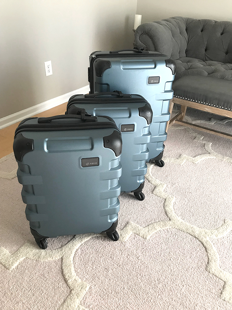 set of tumi tech luggage in blue