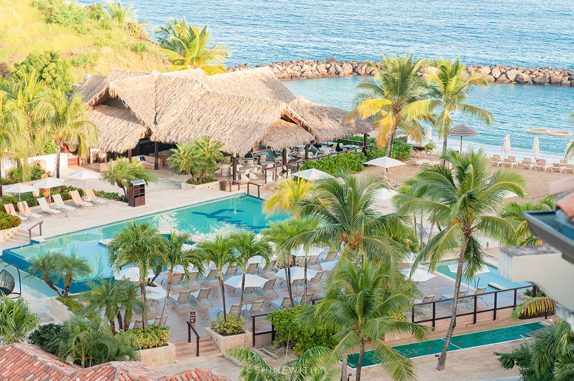 pink gin village infinity pool at sandals grenada resort