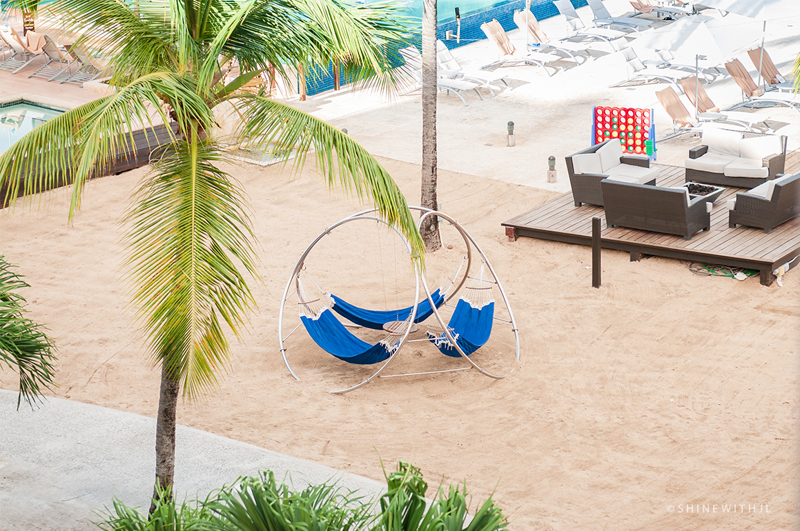 trio of blue hammocks and adult connect four game sandal grenada resort