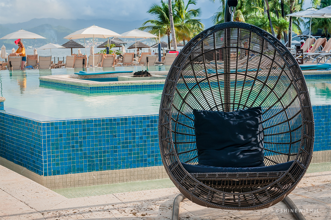 hanging wicker chair by infinity pool at sandals grenada resort