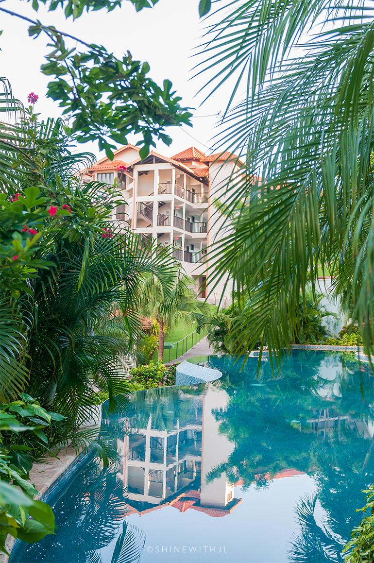 Pink Gin Village Building reflected in infinity pool at Sandals Grenada Resort