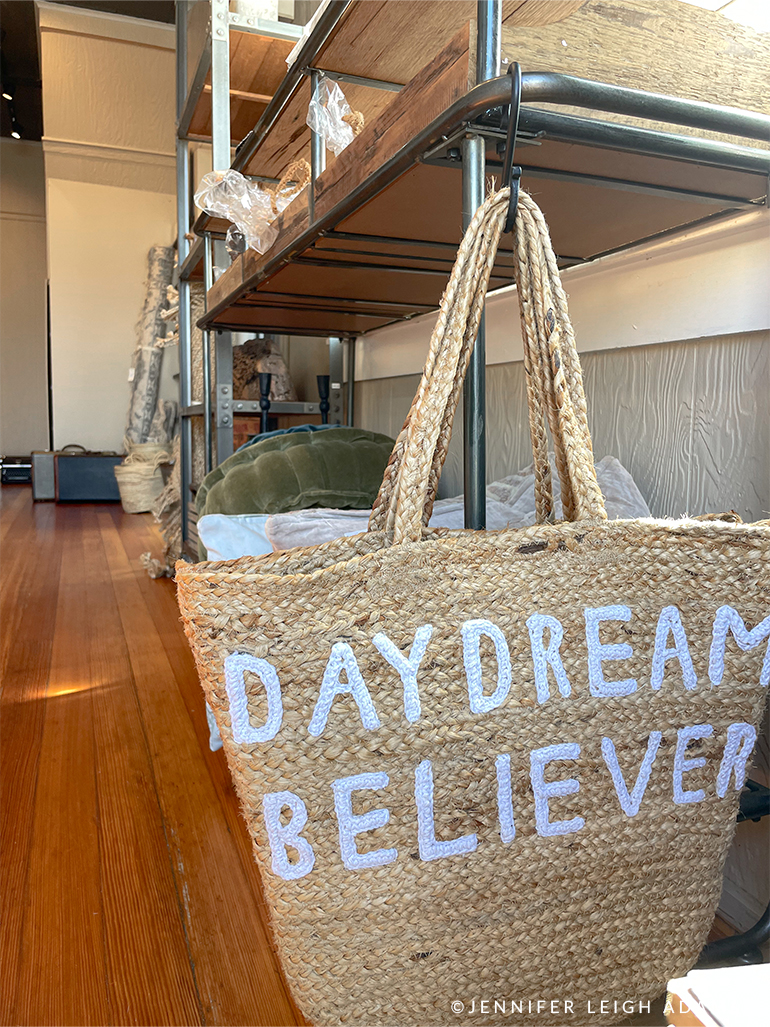 daydream believer woven tote bag