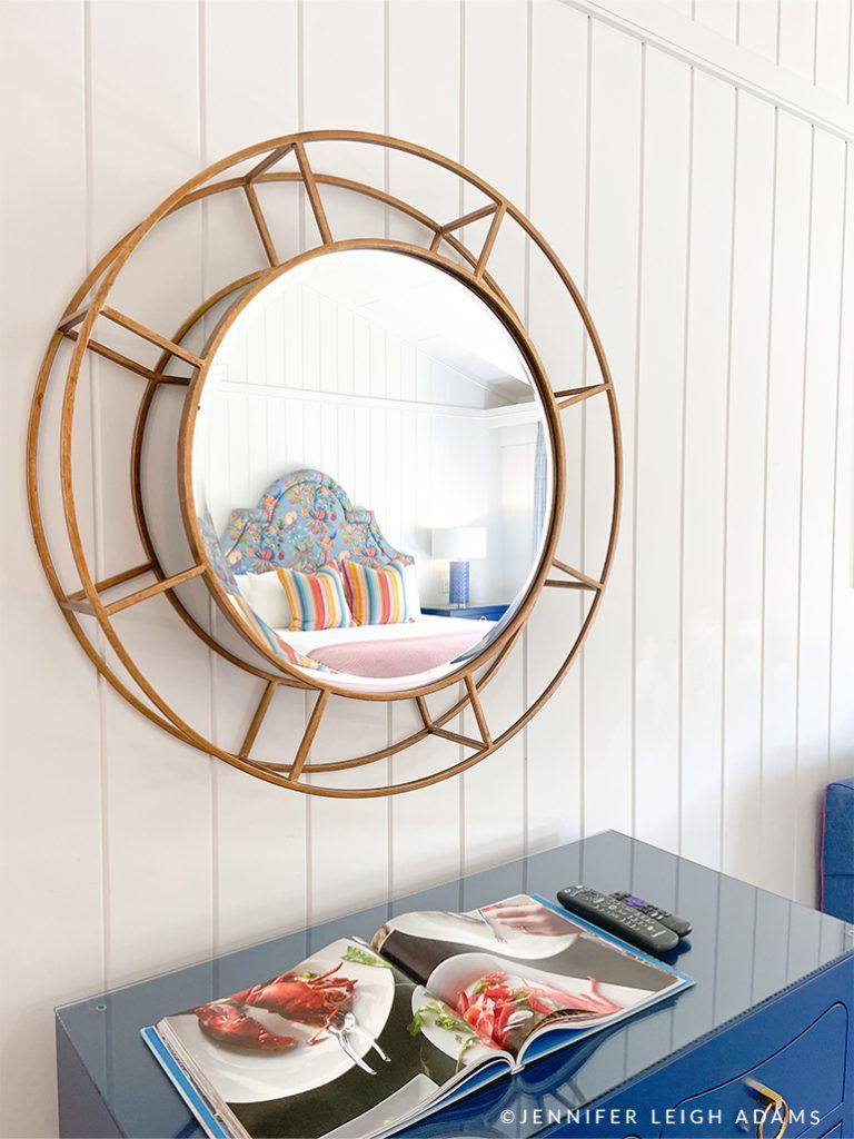 round gold mirror shiplap walls rooms at yachtsman hotel and marina